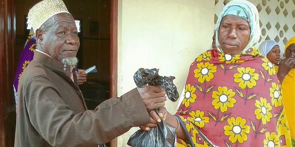 A widow receiving Qurbani meat in Kenya